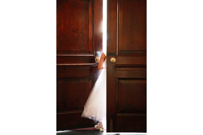 flower girl standing by a door way of Unitarian Church NYC