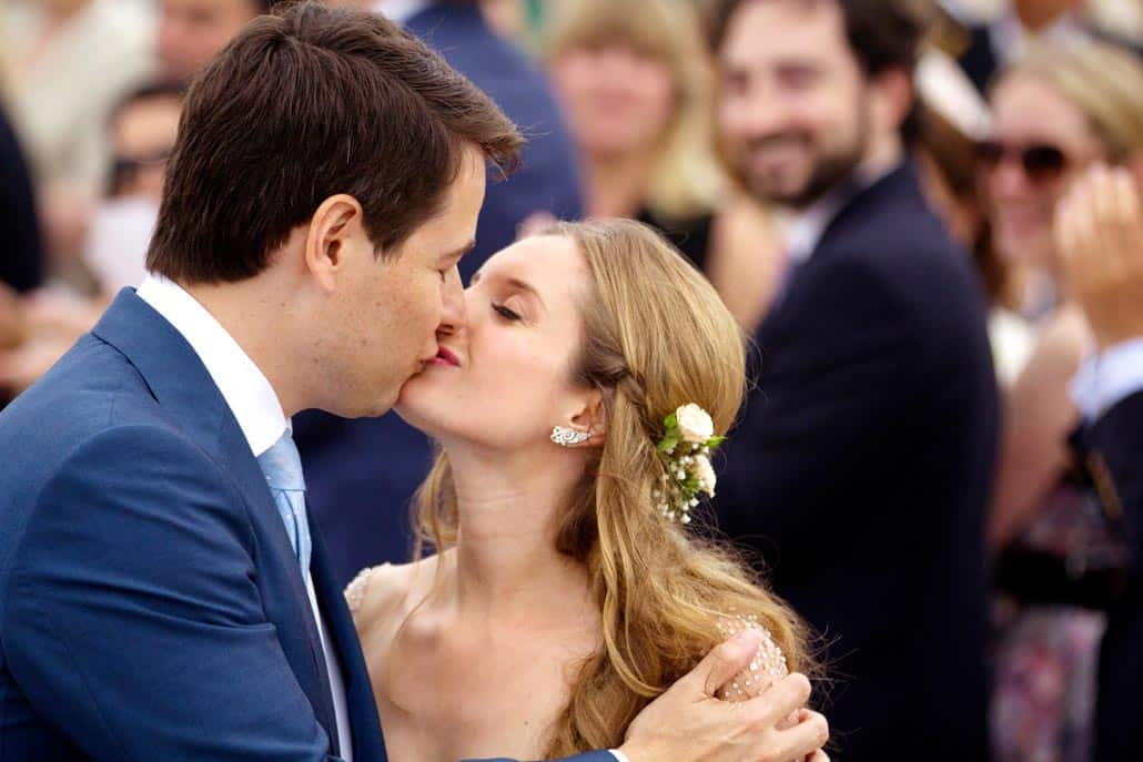 Bride and groom kiss after ceremony, Summer Hamptons beach wedding at Quogue Beach Club, NY