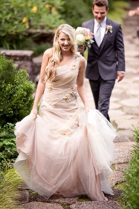 Bride and groom taking a walk at Greenwood Gardens, Short Hills, New Jersey