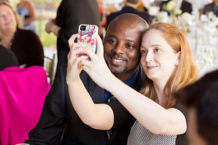 a couple taking selfie during wedding reception at Chauncey Hotel & Conference Center, Princeton, NJ