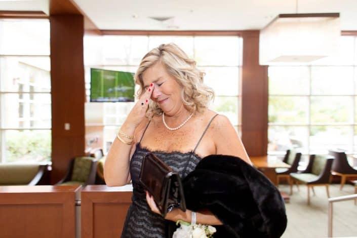 bride walking by and woman getting emotional at wedding at Hyatt Regency Princeton