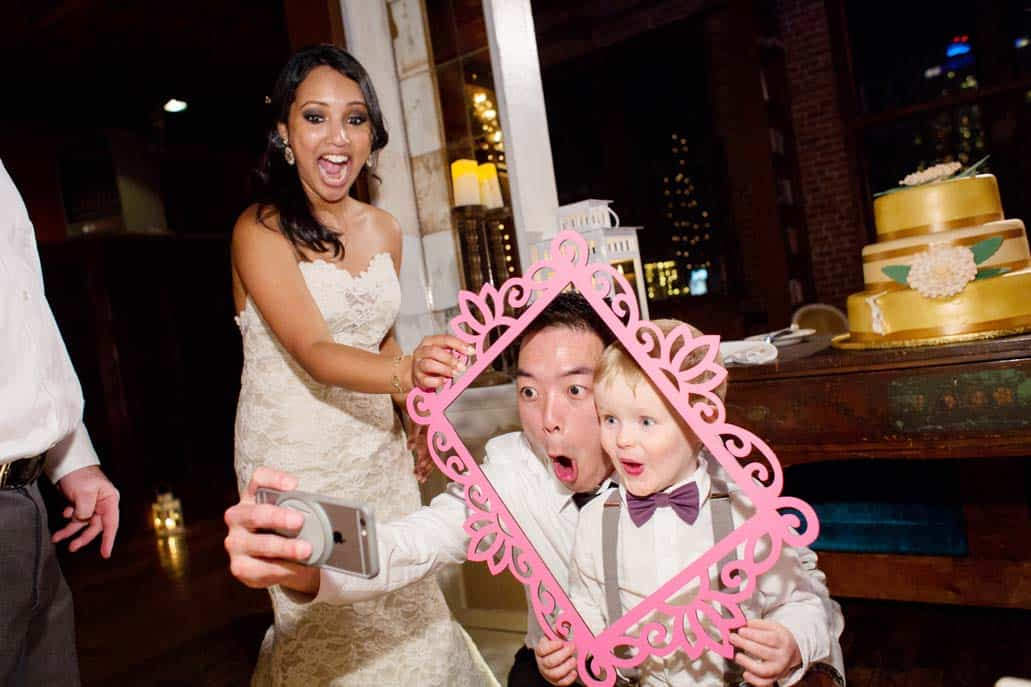Metropolitan Building wedding reception: Picture time with bride, groom, and ring bearer