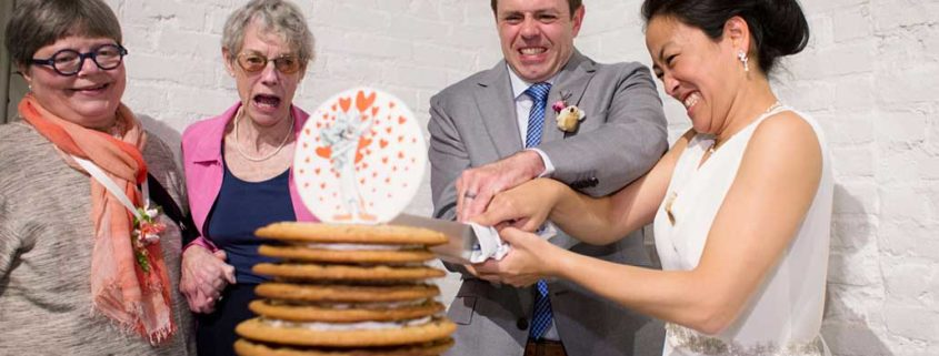 Rustic wedding cookie cake cutting, at Invisible Dog Art Center, Brooklyn, NY