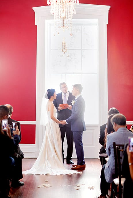 Red wall wedding ceremony at India House, NYC