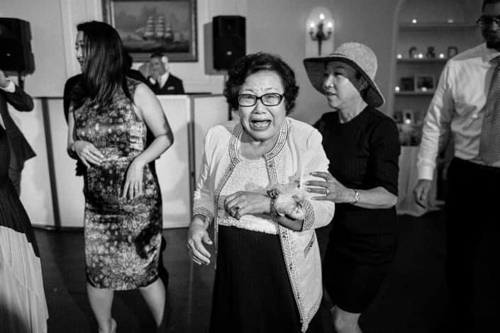 A grandma dancing at a wedding reception at India House NYC