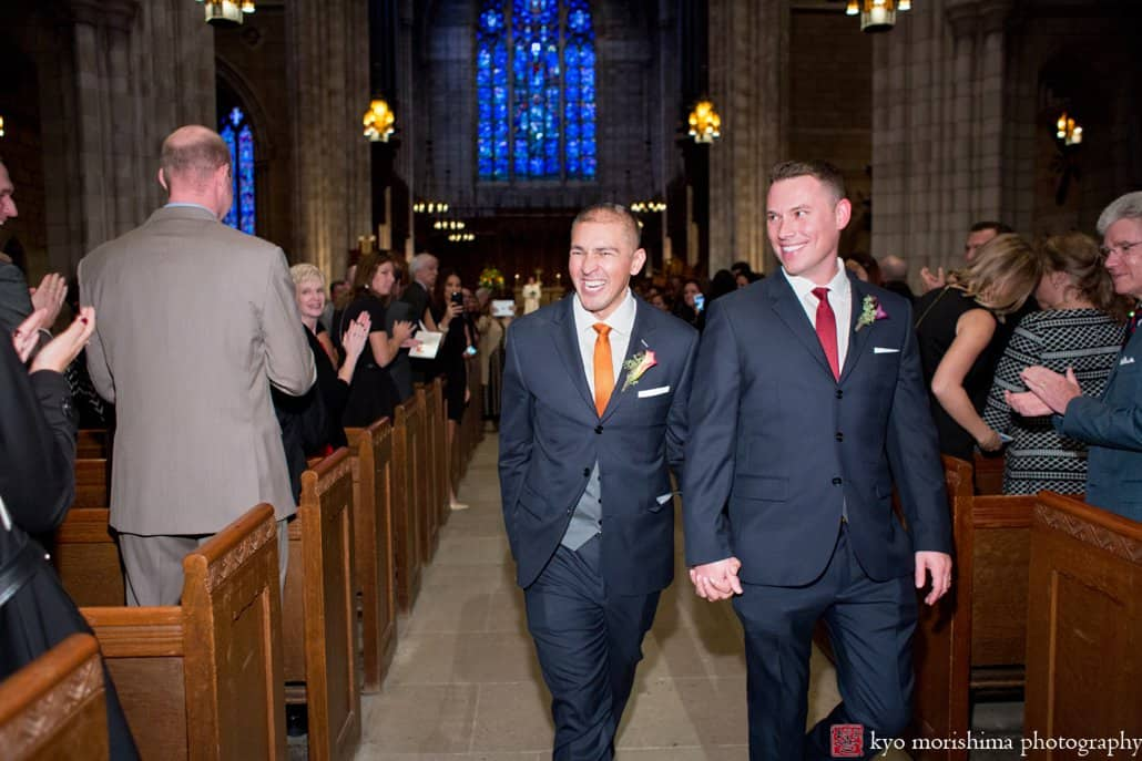 Same sex couple smile as they depart wedding ceremony at Princeton University Chapel