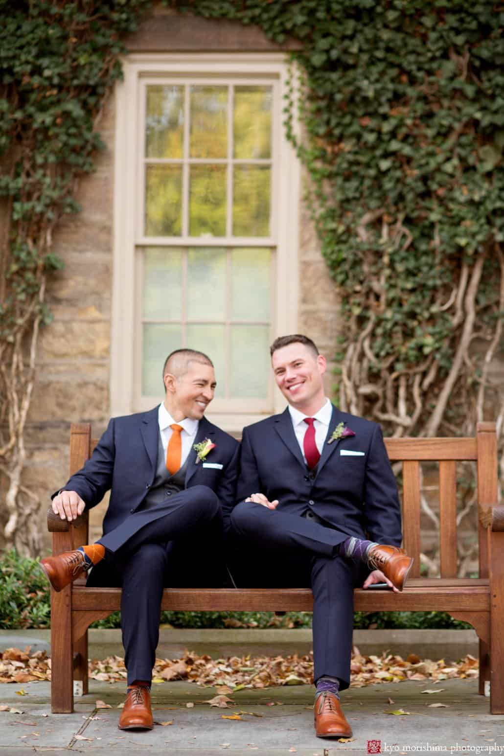 Princeton same sex marriage wedding portrait on a park bench framed with ivy