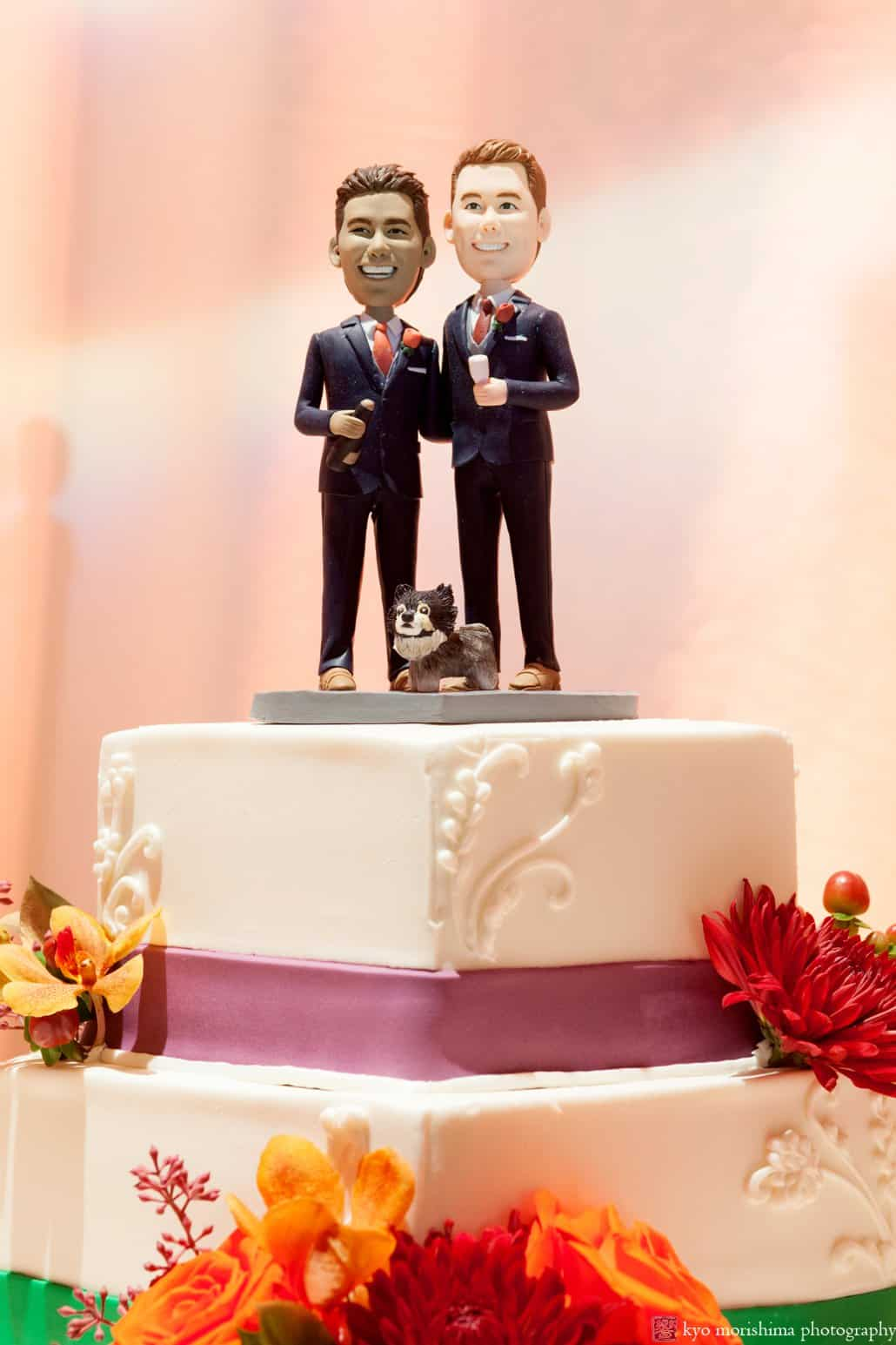 Bobblehead wedding cake toppers with cake by Cramer Bakery