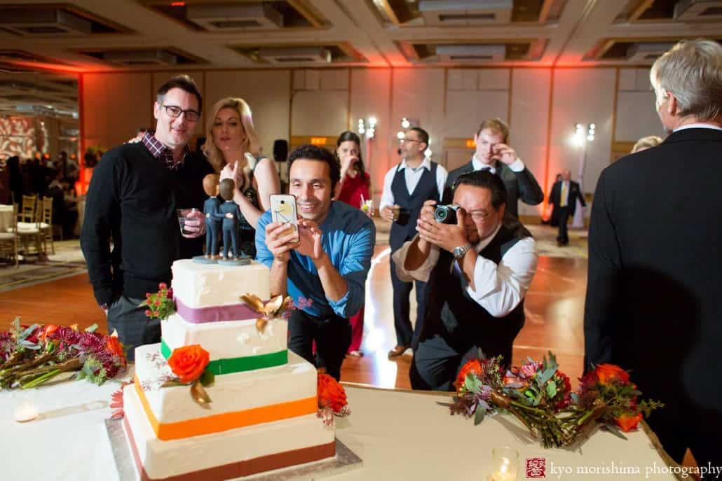 Guests photograph bobblehead wedding cake toppers at Hyatt Regency Princeton wedding reception