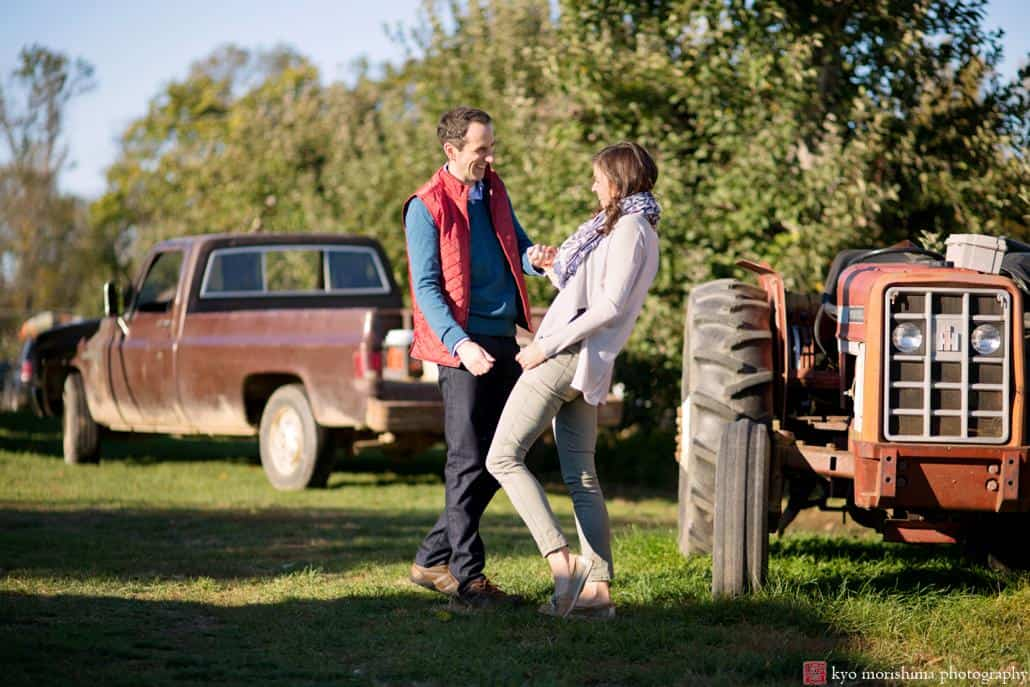 A couple laughs during engagement session at one of NJ's best outdoor photography spots: Terhune Orchards in Princeton.