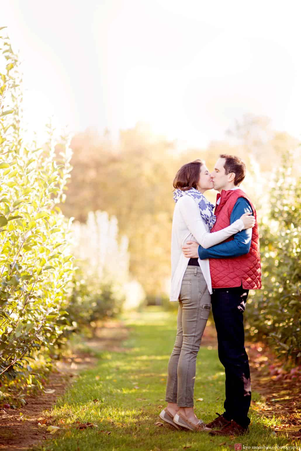 A kiss at Terhune Orchards, photographed on a brisk fall day by NJ engagement photographer Kyo Morishima