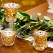 Italian ruscus greenery wedding decor with gold tea candle receptacles at the Nassau Inn's Princeton wedding show