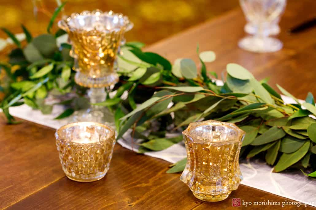 Unique and simple wedding ideas: Italian ruscus greenery wedding decor with gold tea candle receptacles at the Nassau Inn's Princeton wedding show
