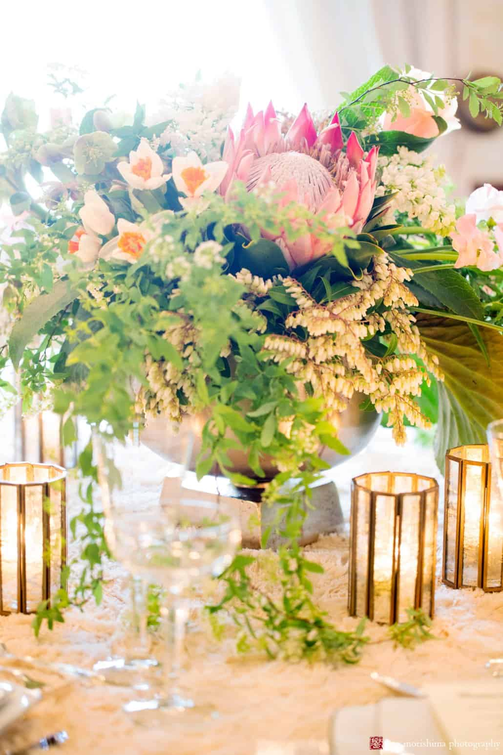 Unique and simple wedding idea: a single protea flower in tabletop centerpiece. This design is by Viburnum Designs in Princeton.