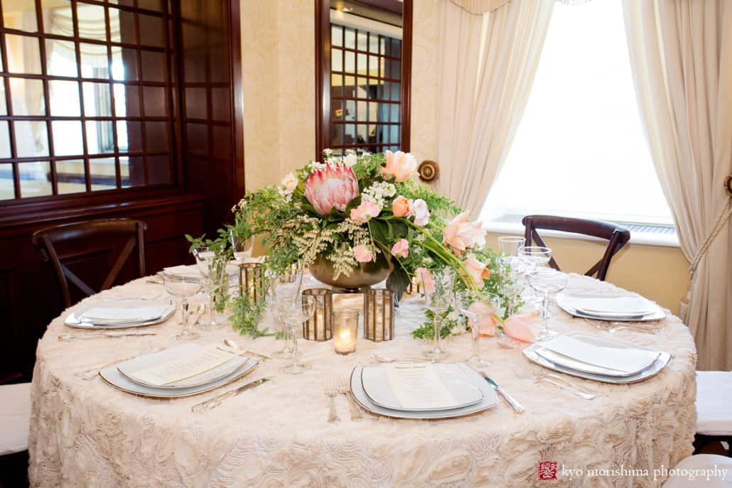 Wide view of flower arrangement with protea; wedding centerpiece by Viburnum Designs in Princeton.