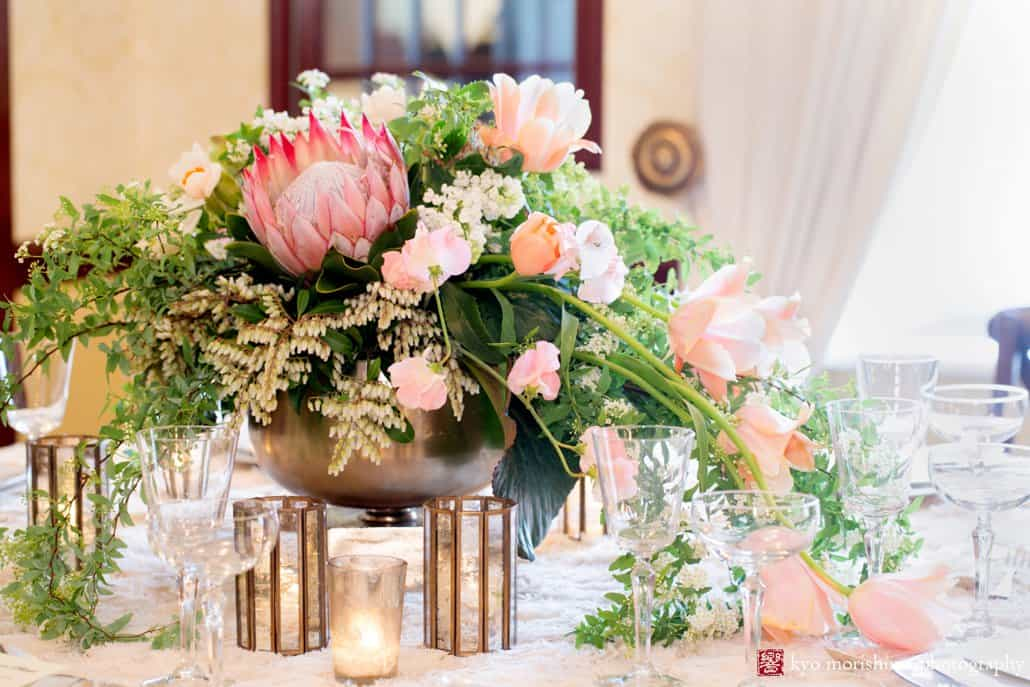 Protea flower wedding centerpiece with cascading pale pink tulips, by Viburnum Designs in Princeton