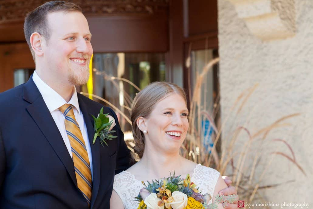 Bride and groom smile at friends as they stand in front of the door: Bernards Inn fall wedding photos