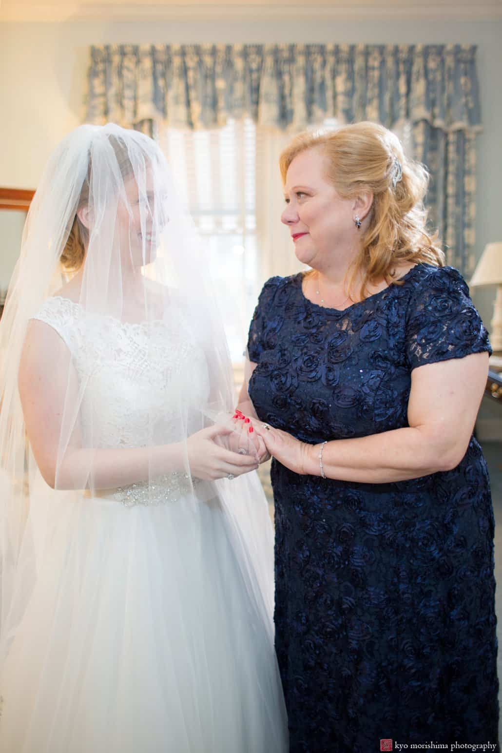 Bride and mother look into each other's eyes as they stand in the bridal suite at Bernards Inn in Bernardsville, NJ