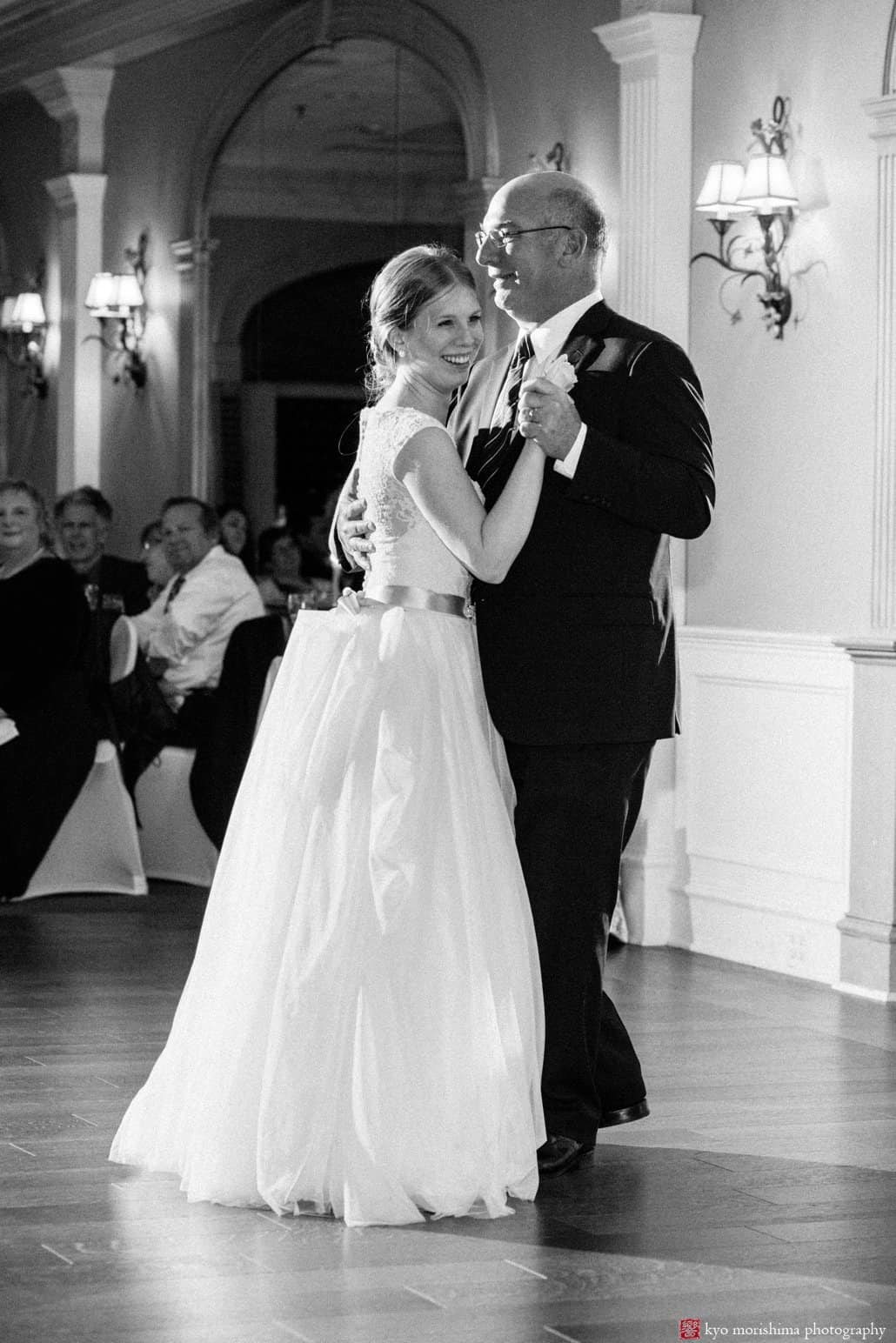 Bride smiles happily during father-daughter dance: Bernards Inn wedding photos in candid style by Kyo Morishima