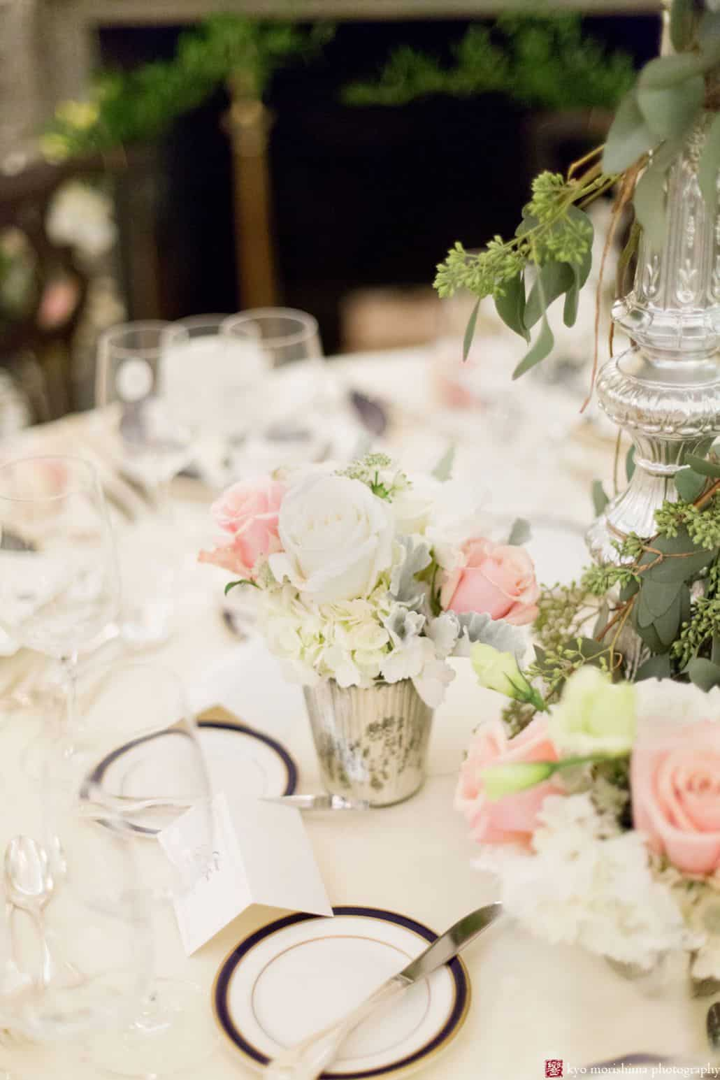 Winter wedding table top floral arrangements at the Lotos Club in NYC with pink and white roses, eucalyptus leaves, and hydrangea. Wedding flower design by Fleur du Mois.