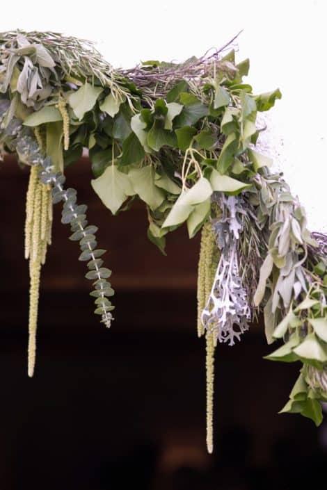 Sage, green and purple archway at European destination wedding in Swiss Alps. Gardenias Floral, Waldhaus Hotel