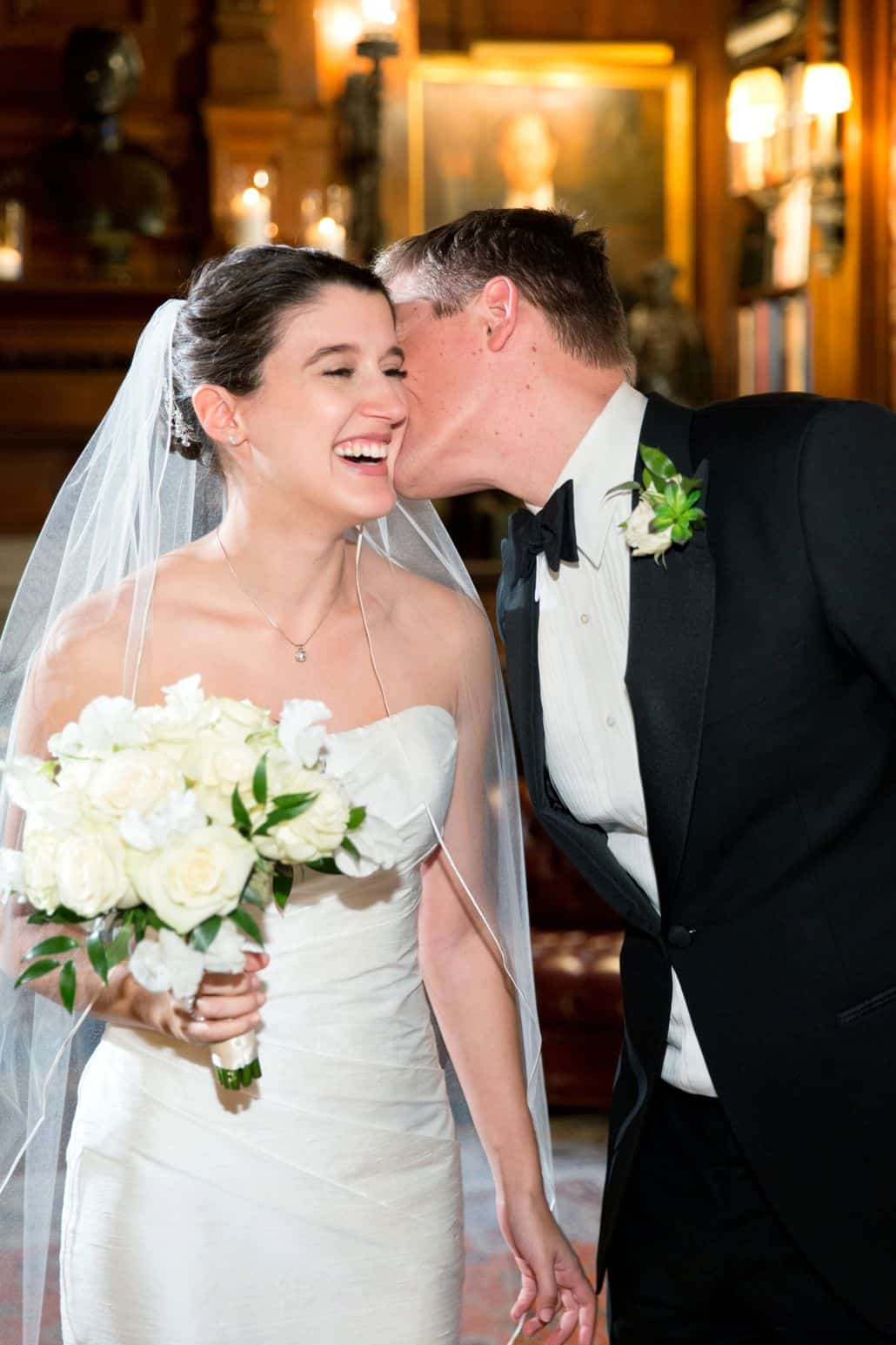 Groom kisses brides cheek as she smiles at Lotos Club Wedding in NYC ...