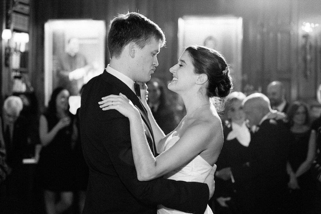 Bride and groom look into each others eyes as they have their first dance in Lotos Club Library in New York. Veka Bridal wedding gown. Lotos Club wedding photographer.