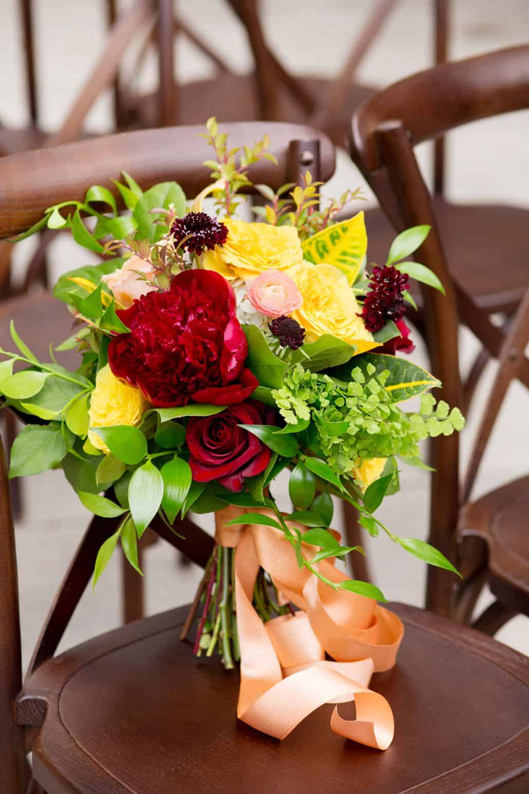 Deep Red Bright Yellow Pink And Green Wedding Bouquet Roses