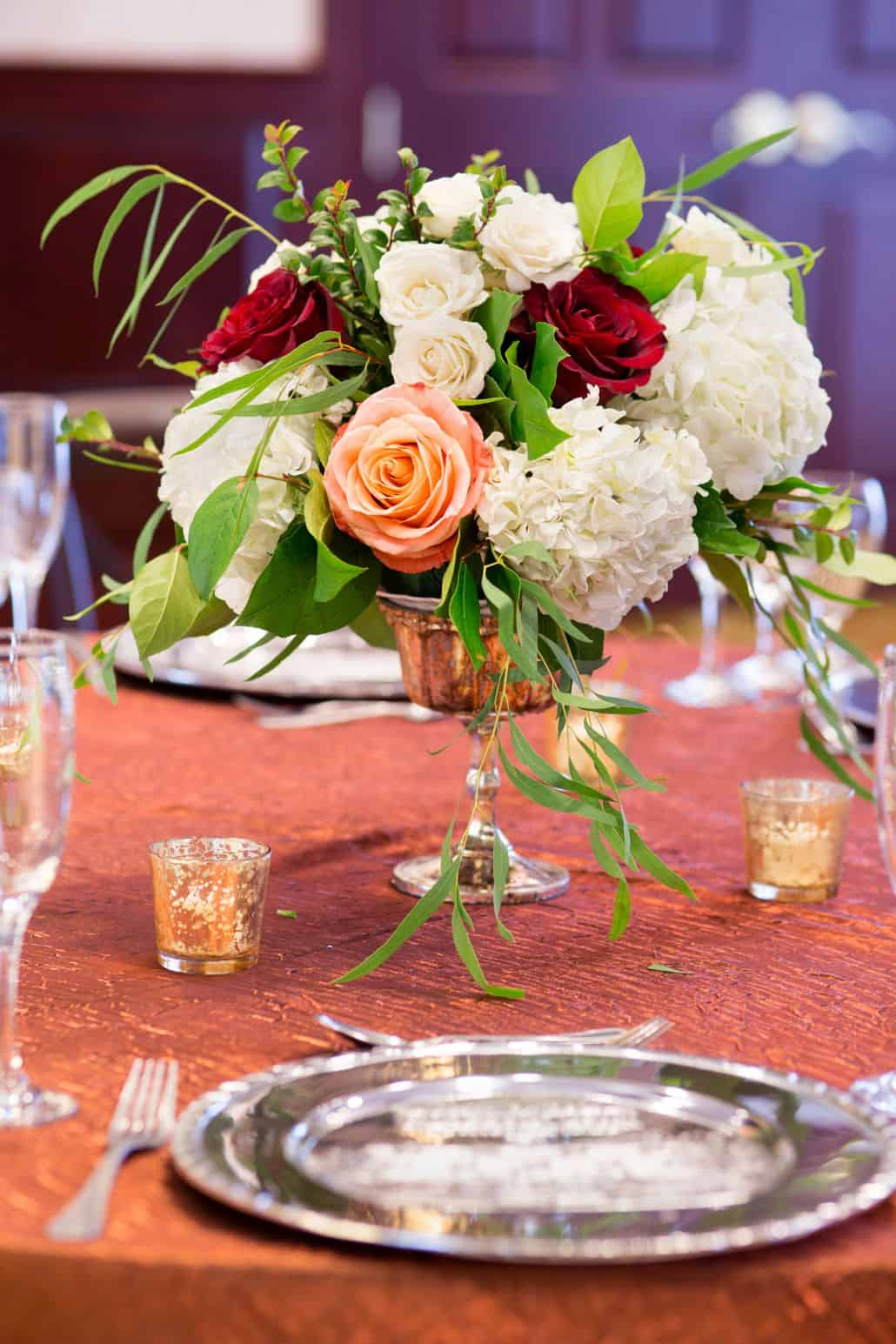 red roses, white roses and hydrangeas and peach roses in mercury ...