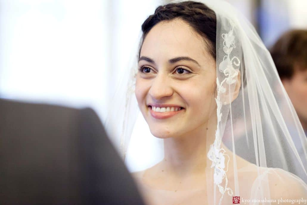 Portrait of bride with lace trimmed veil during NYC City Hall elopement wedding