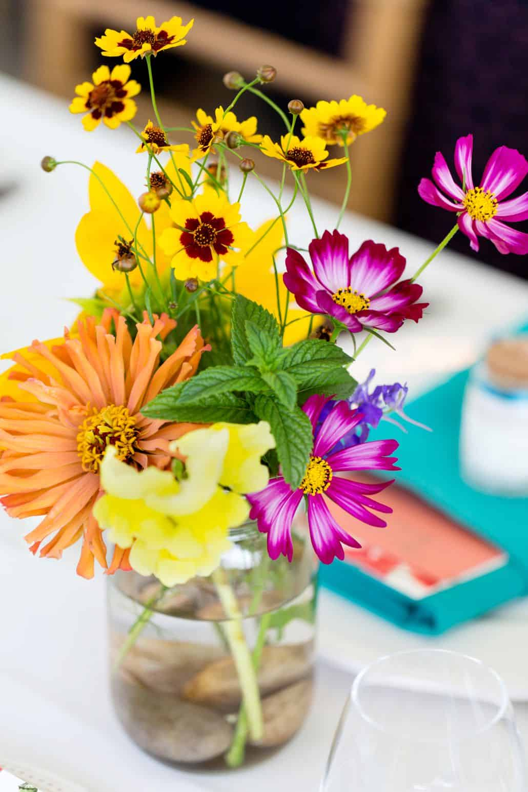 Bright Pink Yellow And Orange Wildflowers With Mint In Mason Jars