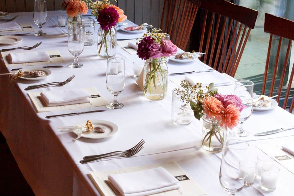 Wedding Table Linens.Peach Dusty Rose And Burgundy Dahlias And Roses In Mason Jars For