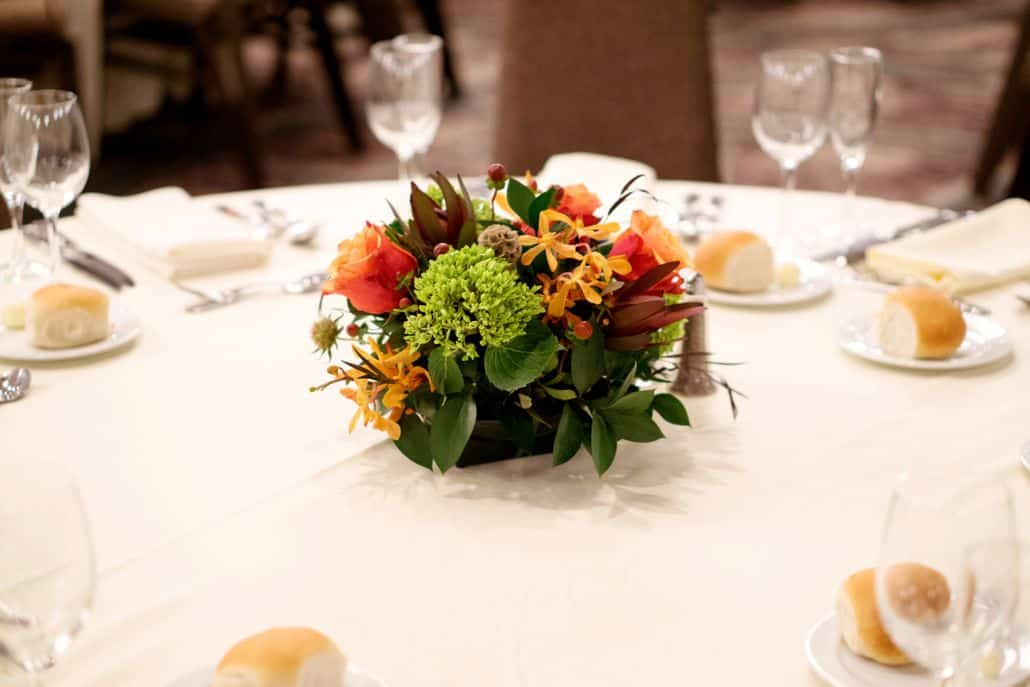 Burnt orange burgundy and green wedding table centerpiece floral