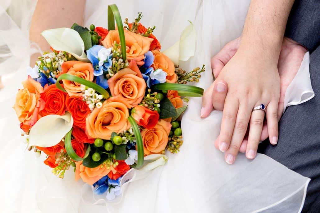 Orange blue and white wedding bouquet roses calla lilies bride orange blue and white wedding bouquet roses calla lilies bride holds bouquet mightylinksfo