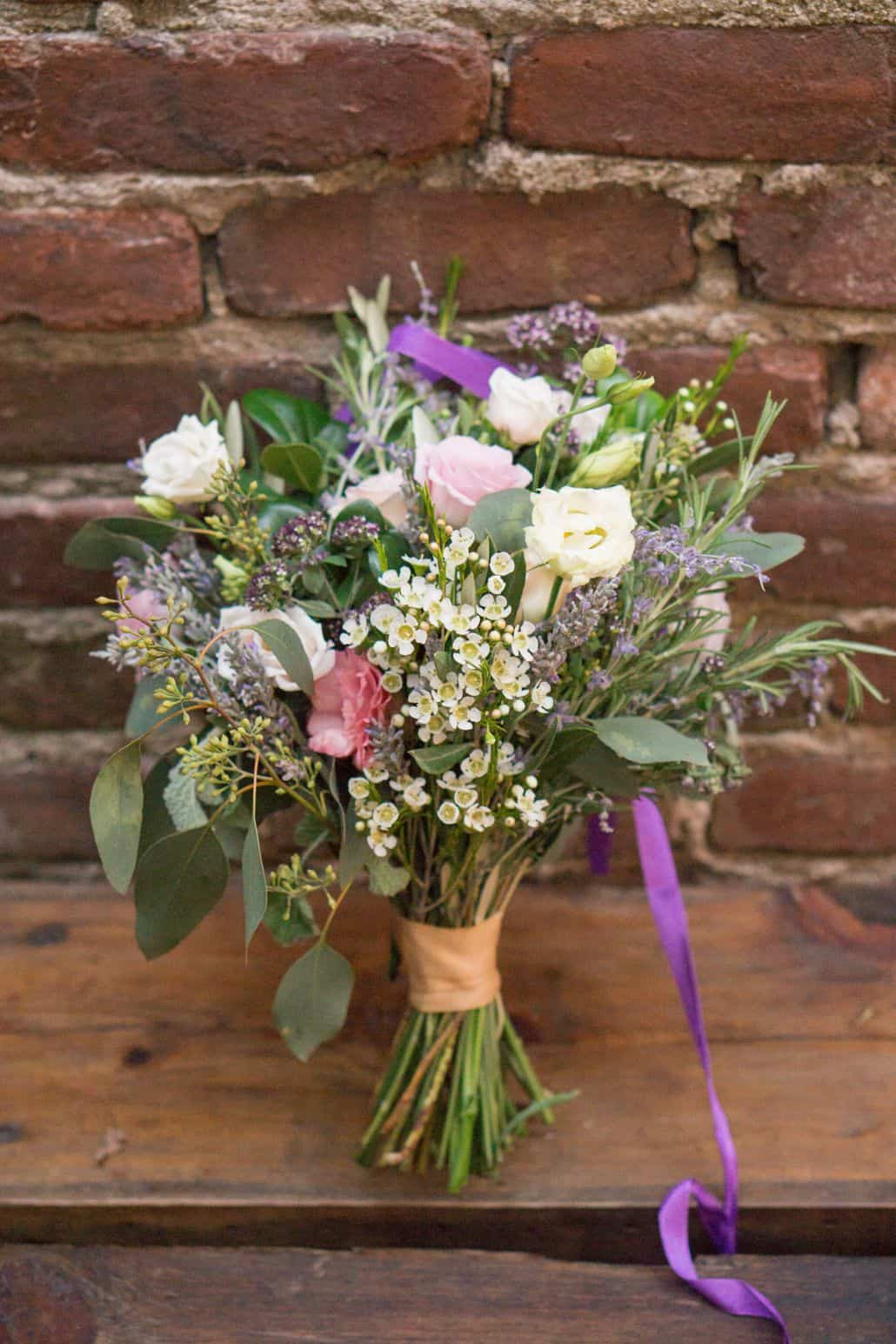 bridal bouquet on wooden ledge in front of old brick wall vintage ...