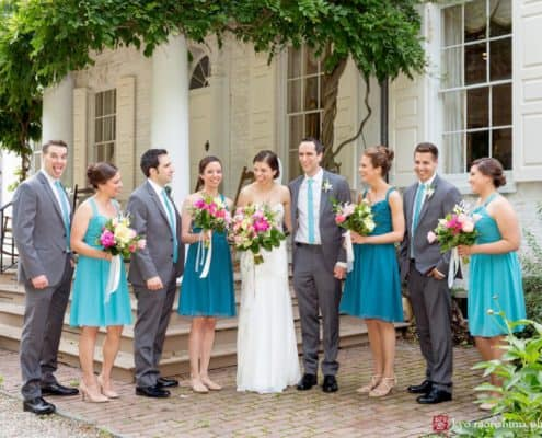 Morven House wedding party portrait with Chinese wisteria draped across porch in the background