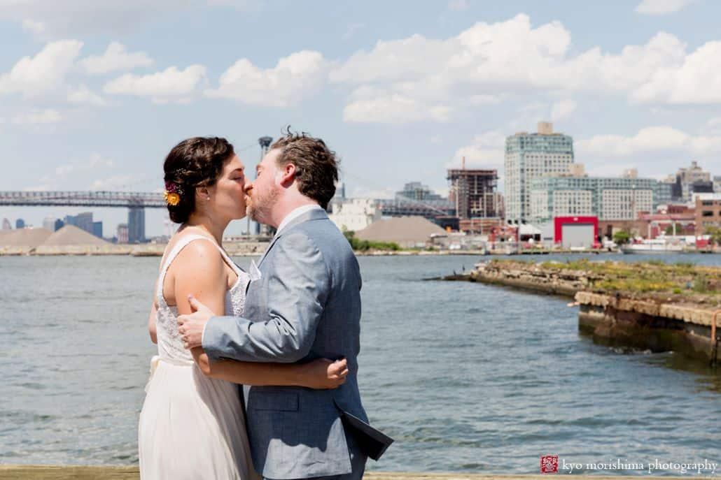 First look kiss along the waterfront at Brooklyn Grange wedding at the Navy Yard