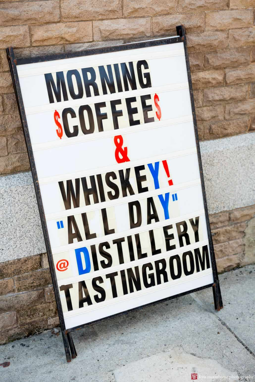 Morning coffee and whiskey signage outside Kings County Distillery at Brooklyn Navy Yard