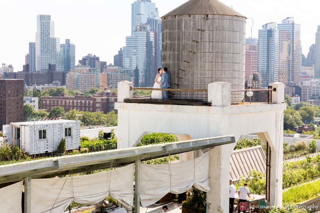 Brooklyn Grange wedding photos with watertower and cityscape in the background