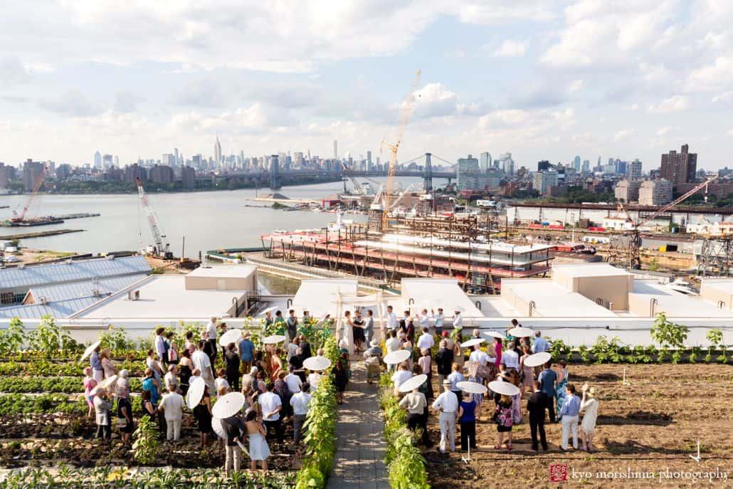 Brooklyn Grange wedding photos: ceremony overlooking the waterfront Navy Yard
