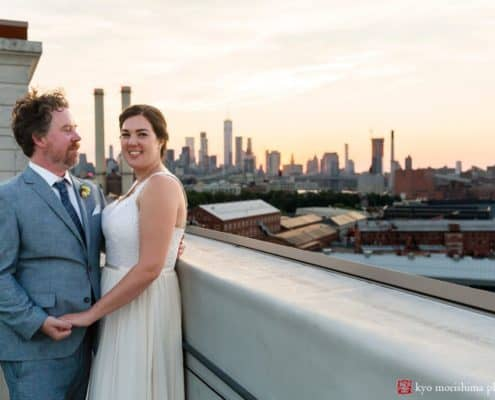 Industrial wedding portrait at the Brooklyn Grange rooftop overlooking industrial landscape