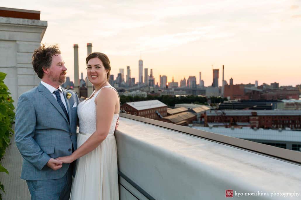 Industrial wedding portrait at the Brooklyn Grange rooftop overlooking industrial landscape