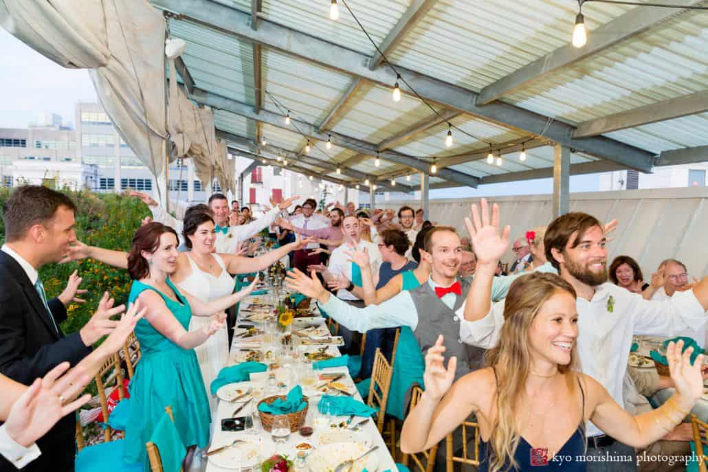 Guests offer toast at Brooklyn Grange wedding reception