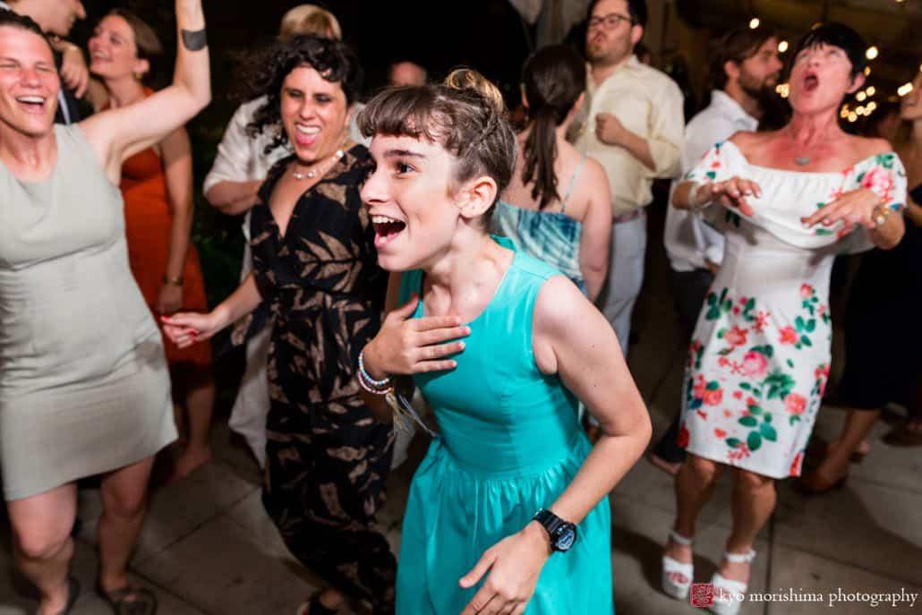 Bridesmaid wearing teal dress parties at Brooklyn Grange wedding celebration