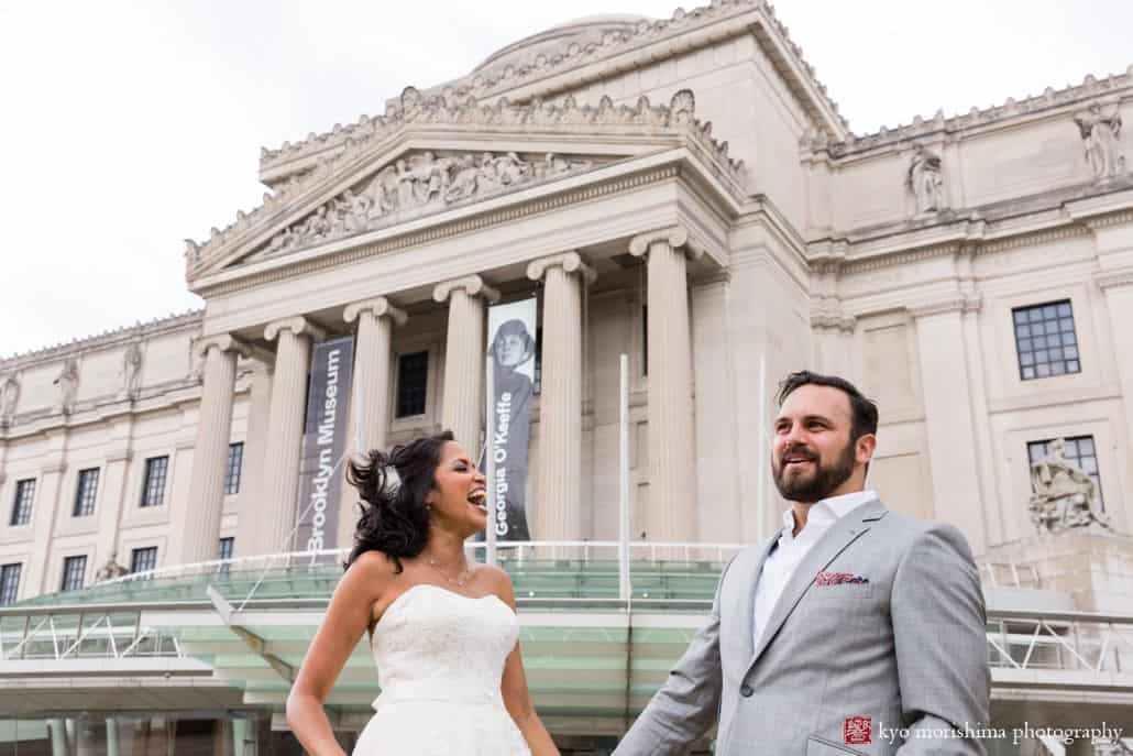 Brooklyn Museum wedding photos: portrait of bride and groom with front entrance behind them