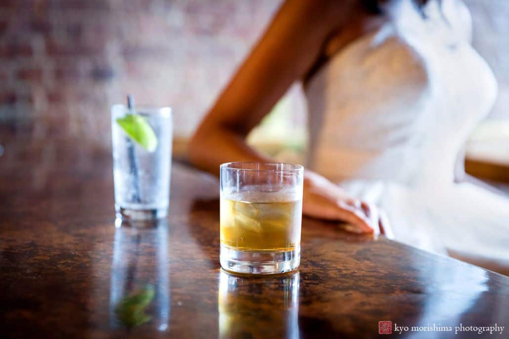 The Crown Inn bar in Crown Heights, brooklyn: two drinks with Bride's torso in the background