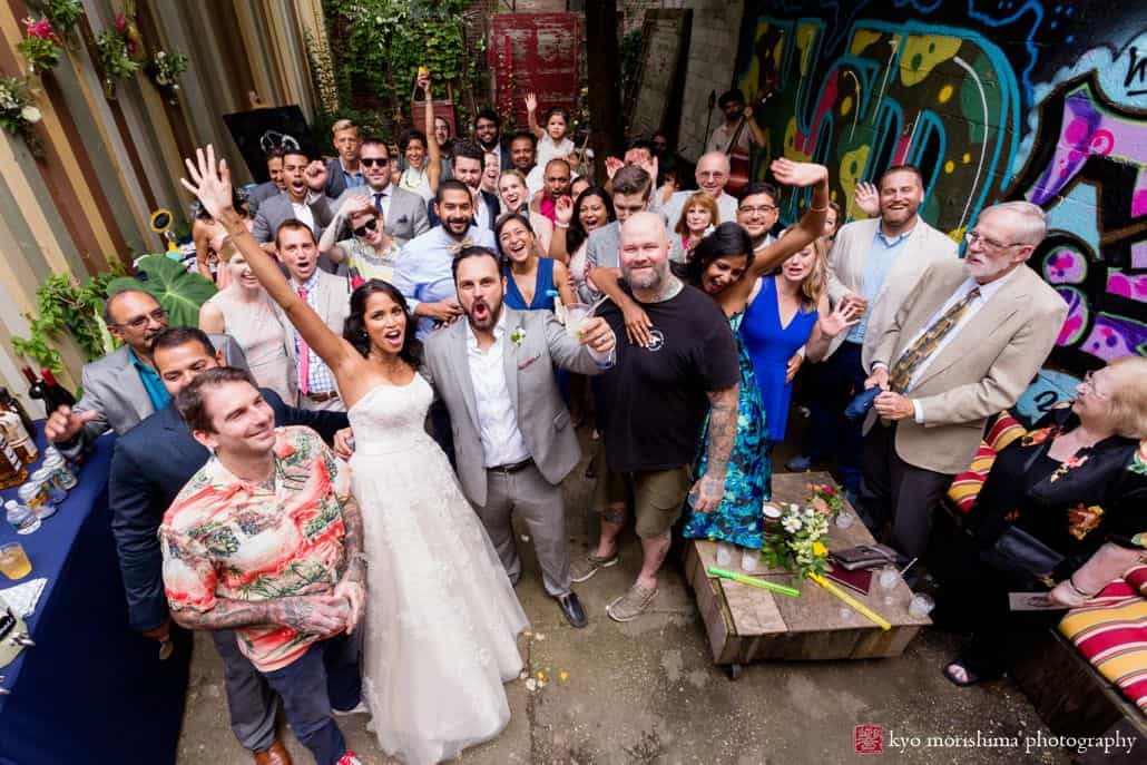 Creative wedding photo ideas: everybody is in the shot at the end of the ceremony at Electric Anvil Tattoo in Brooklyn