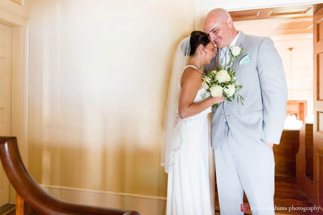 Bride rests forehead on groom's shoulder after wedding ceremony at Hunterdon County courthouse, BHLDN wedding gown, Men's Warehouse suit, pale teal tie and pocket square, The Pod Show Flowers white rose bridal bouquet, New Hope, PA wedding photographer.