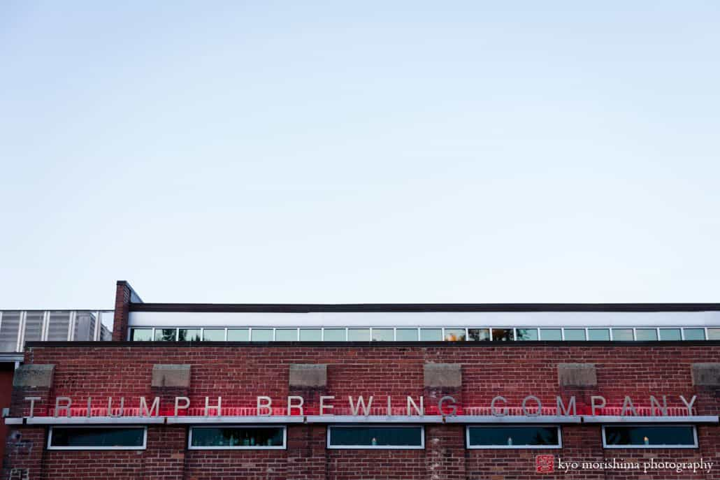 Triumph Brewing Company building sign, red brick, red neon lights, New Hope, PA intimate wedding photographer.