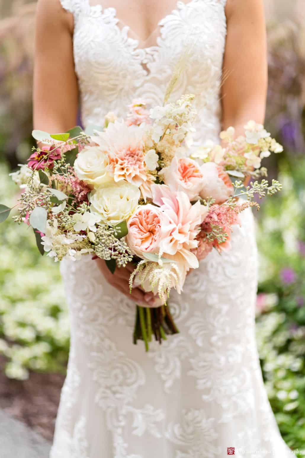 Bridal bouquet photo, white and pale pink/peach flowers with burgundy accents, roses, peonies, astilbe, eucalyptus, hydrangea, natural wedding bouquet, Fox Hill Farm Experience florist, poconos outdoor wedding photographer.